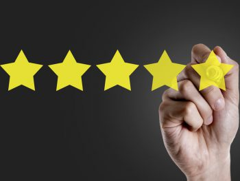 Hand choosing 5 Star Rating